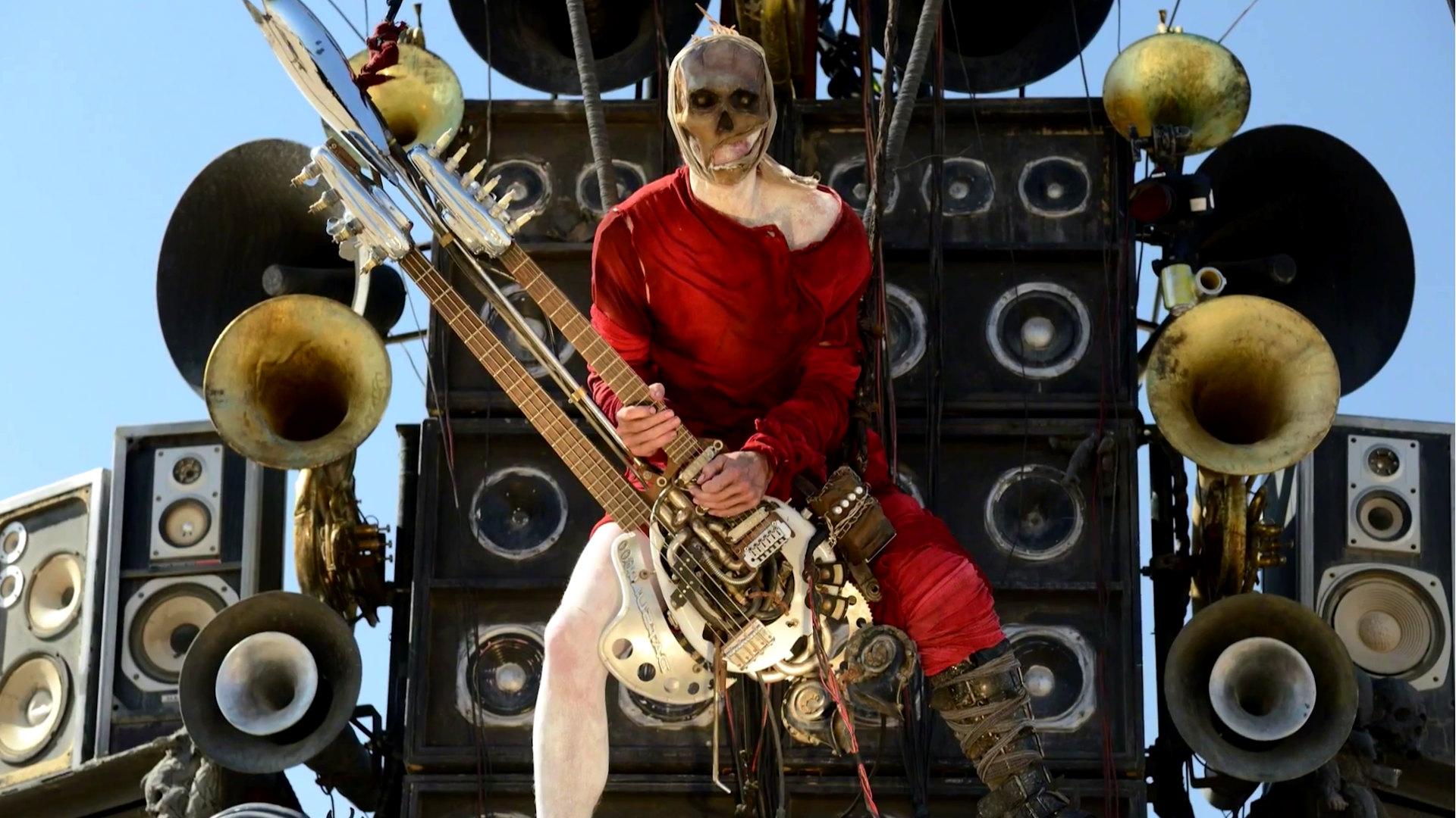 Гитарист Безумный макс